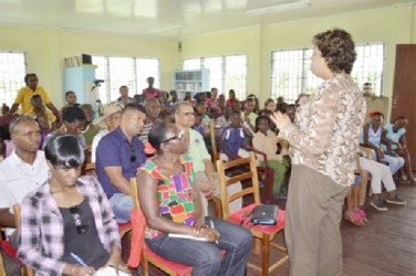 Minister of Education, Priya Manickchand interacting with parents at the Cummings Park Community Centre. (GINA photo)