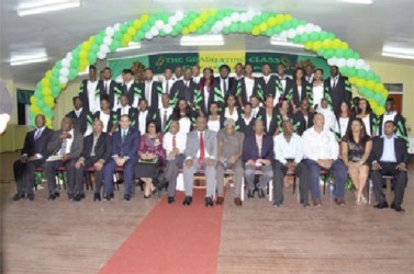Minister of Agriculture Dr. Leslie Ramsammy and ICCA's Country Representative Wilmot Garnett with the GSA Board of Director, staff and part of the 2014 graduating class in the Diploma in Agriculture (GINA photo)