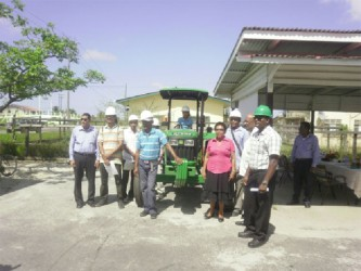 Several persons from Tapakuma who completed training in the operation and maintenance of the tractor with officials.