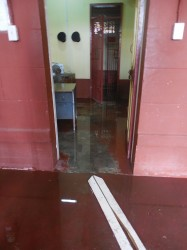 A flooded section of the officer's station as well as one of the holding cells for prisoners.
