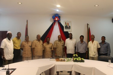 This police photo shows the donors with members of the police force today.