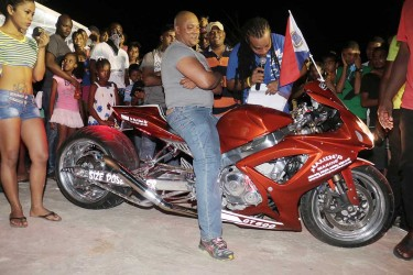 Size does matter! – Havin Ramnauth showcasing his $8M Suzuki 600 self-customized motorcycle which took first prize for the Best Super Bike category of the Lake Mainstay 5th Annual Car and Bike Show held at the Resort on Saturday.