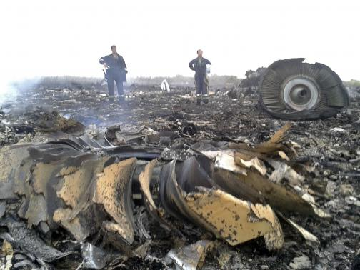 Emergencies Ministry members work at the site of a Malaysia Airlines Boeing 777 plane crash in the settlement of Grabovo in the Donetsk region, July 17, 2014. Credit: REUTERS/Maxim Zmeyev