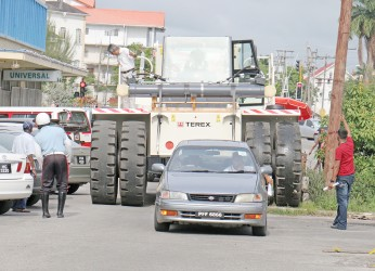 This huge forklift on Church Street had to take its time to avoid clipping vehicles.