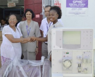 From left: Tara Mohamdee handing over the Dialysis Machine to representatives of the Georgetown Public Hospital Corporation (GPHC). From  right are Nurse in charge of the Renal Department at the GPHC, O'Delevana Kennedy, and CEO of the GPHC Michael Khan with another representative from the hospital. (GINA photo)