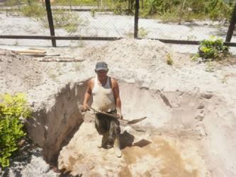 Rickey Jospeh digging a pit