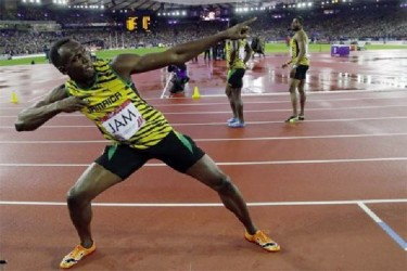 Jamaica's Usain Bolt poses after Jamaica won the men's 4x100m relay final at the 2014 Commonwealth Games in Glasgow, Scotland,  yesterday.CREDIT: REUTERS/SUZANNE PLUNKETT