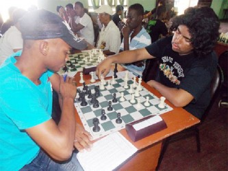 Anthony Drayton and Taffin Khan battle it out during a recent chess tournament. They are both participants in the Tromso Olympiad and are playing for Guyana starting yesterday. The Olympiad lasts for two weeks.