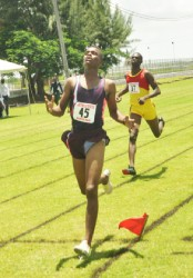 Ornesto Thomas running to victory in the boys 800m. (Orlando Charles photo)
