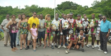 Winners and runners up of this year's 10th annual Reagan Rodrigues road race pose with their winning spoils with Hassan Mohamed and members of the Rodrigues' family. (Orlando Charles photo)