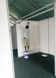 This worker was painting the discolored board when Stabroek News visited yesterday