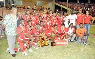 Newly crowned three time defending national champions Christianburg/Wismar Secondary posing with their championship trophy, medals and prize money while Prime Minister Samuel Hinds (extreme left) and representatives of tourney sponsors Digicel look on