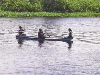 Women boating to a community event