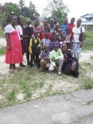 All of us! My mother, extreme right with her six daughters and sixteen grandchildren after church