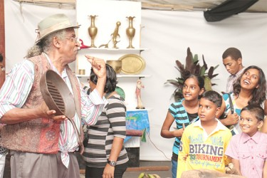 A storyteller entertains patrons as they stop in for a listen