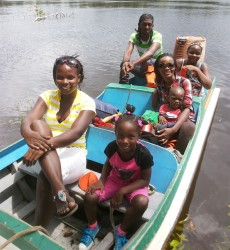 Our arrival: My sister Ernana and her daughter Akeelah, myself and my youngest Nickhol, my sister Akeisha and boat captain Sherlock Lindie (my cousin who opened his home to us) minutes after our arrival