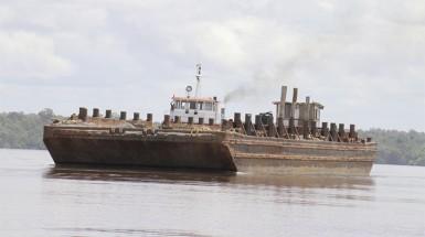 A barge transporting Vaitarna logs