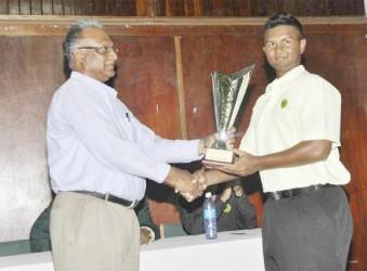 Guyana skipper Brian Sattaur receiving the winning trophy from Director of Sport Neil Kumar