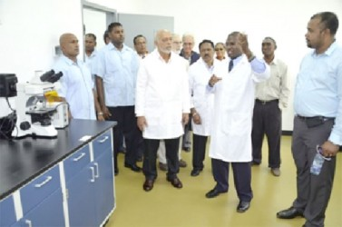 President Donald Ramotar being given a tour of the new lab by Dr. Dane Hartley (second from right), Manager Designate of the lab (second from right) (GINA photo)