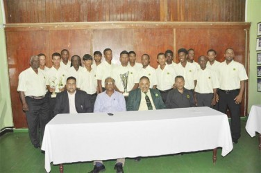 The Guyana team (standing) with GCB officials and Director of Sport Neil Kumar seated second from left.