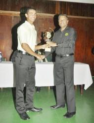 Tagenarine Chanderpaul receiving the MVP award from GCB secretary Anand Sanasie.
