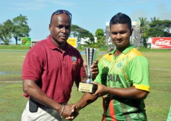 AYE, AYE  SKIPPER!  Guyana's skipper Brian Sattaur receiving the winning trophy from Rawl Lewis.