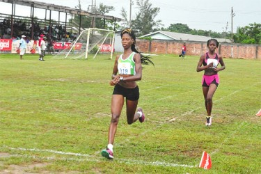 Grenada's Kenisha Pascal about to cross the finish line way ahead in the 3000m. (Orlando Charles photo)