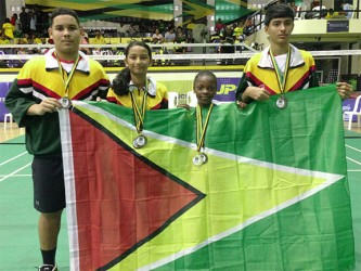 The Guyana players with their medals and the Guyana Flag.