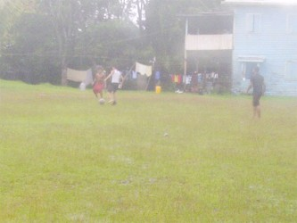 Playing football in the rain