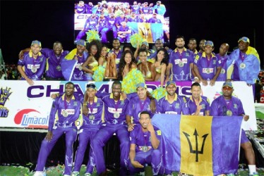 The victorious Barbados Tridents team celebrate after their win last night.