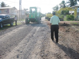 Vice Chairman Bhupaul Jhagroo inspecting the road under construction at Tucber Park, New Amsterdam