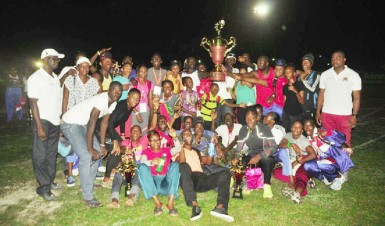 The Police Progressive Youth Club track and field outfit posing with the winner's Boyce/Jefford Classic Trophy. (Orlando Charles photo)