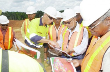 President Donald Ramotar along with Canadian High Commissioner to Guyana, Nicole Giles and several other Cabinet members yesterday visited the Guyana Goldfields, Aurora, Cuyuni operations.  In this GINA photo, Ramotar (second from right) and Minister of Public Works Robeson Benn (right) being briefed on progress of works by Chief Executive Officer Scot Caldwell.