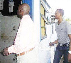 (from left) Inspector Thornton and Constable Forrester entering the Sparendaam Police Station following their arraignment on July 8.
