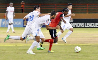 Alpha United's Gregory `Jackie Chan' Richardson on the go in the match against Club Deportivo Olimpia. (Orlando Charles photo)