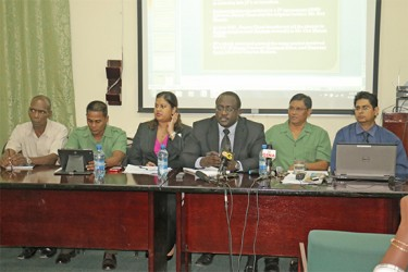 Guyana Forestry Commission (GFC) commissioner James Singh (second from right), GFC's legal officer Jacy Archibald (third from right), GFC Head of Planning and Development Division, Pradeepa Bholanauth (third from left), Deputy Commissioner of Forests Tashreef Khan (second from left) and other GFC officials at the news conference yesterday.