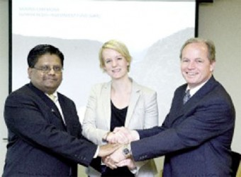 From left to right: Minister of Finance Dr Ashni Singh, State Secretary, Ministry of Foreign Affairs, Norway Ingrid Fiskaa and Vice President for Concessional Finance and Global Partnerships, World Bank Axel van Trotsenburg seal the setting up of the Guyana REDD+ Investment Fund in October 2010.