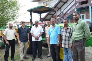 Local Government and Regional Development Minister Norman Whittaker (third from left) handing over the bobcat and tractor and trailer. (GINA photo)