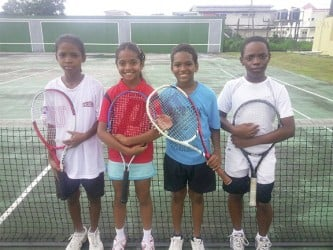 National U-12 lawn tennis team members (from left to right): Kalyca Fraser, Sarah Klautky, Vijay Sharma and Antoinne Andries