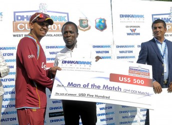 Sunil Narine receives the Man of the Match prize from Grenada PM Dr. Keith Mitchell during the 2nd Dhaka Bank ODI West Indies v Bangladesh at Grenada National Stadium, St. George's, Grenada  yesterday. WICB Media Photo/Randy Brooks