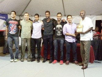 The Guyana male  (above) and female (below) squash teams which retained their men's and women's team titles at the 22nd annual Caribbean Squash Championships which ended in Barbados last evening.