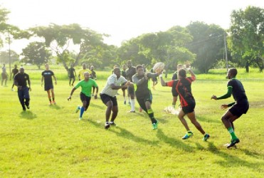 Ruggers practicing their passing yesterday at the National Park rugby field. (Orlando Charles photo)