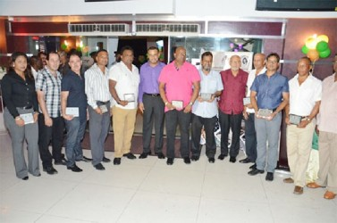 Mining sector awardees with President Donald Ramotar (fourth from right) and Minister of Natural Resources and the Environment, Robert Persaud(GINA photo)