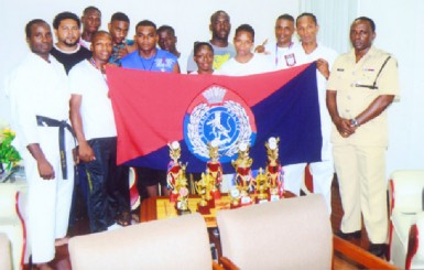 The Guyana Police Force Karate team with the Force Training Officer, Senior Superintendent Paul Williams in Police uniform (far right).