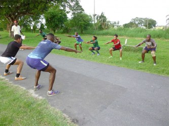 ON THE ROAD TO MEXICO! The national rugby sevens squad under the watchful eyes of Barrington Browne doing fitness drills at the National Park yesterday.