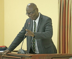 Lieutenant Colonel Sydney James makes a point from the witness stand yesterday during the Walter Rodney Commission of Inquiry