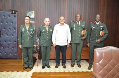 Brazilian military officials yesterday called on President Donald Ramotar (centre)  at the Office of the President. From right to left are: Brigadier Bruce Lovell of the Guyana Defence Force (GDF),  Chief of Staff of the GDF, Brigadier Mark Phillips, Lieutenant General Decio Luis Schons and another official of the Brazilian Ministry of Defence. (GINA photo)