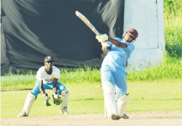 Jeetendra Sukhdeo smashes a huge six out of the ground during his top score of 45