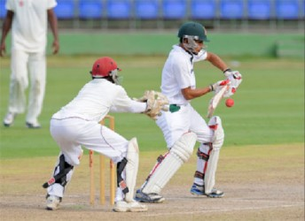 Nasir Hussain prepares to steer a ball past the wicketkeeper during the first day of their three-day tour match against St Kitts/Nevis. (WICB media)