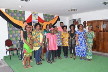 Staff of the Ministry of Housing displaying their emancipation day attire on Thursday. (GINA photo)